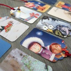 Gift tags made from recycled Christmas cards.  What a great idea!!
