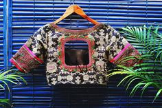 Unique and Stylish Designer Blouse from Mantra Design Studio. Black printed cotton blouse has contrast pink zadosi and thread work on the sleeves. Best Blouse Designs, Saree Blouse Neck Designs, Choli Designs, Dress Designs, Mantra, Designer Blouse Patterns, Blouse Models, Design Studio, Beautiful Blouses