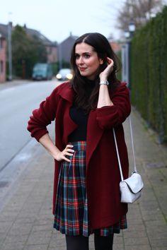 burgundy cardigan, pleated plaid skirt.