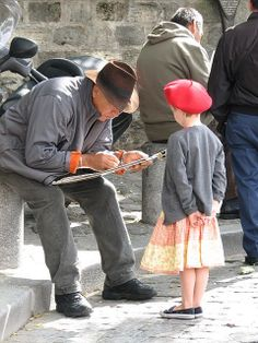 Street artist and young subject in Montmartre