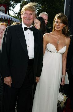 Melania Trump Photos Photos - American game show host and real estate developer Donald Trump (left) and his fiance Melania Knauss attend the 56th Annual Primetime Emmy Awards on September 19, 2004 at the Shrine Auditorium, in Los Angeles, California. Ms. Knauss is wearing a J. Mendel gown and carrying a J. Mendel handbag. - 2004 Primetime Emmy Awards - Arrivals