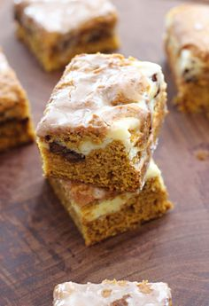 Do you love pumpkin desserts? These Cream Cheese Pumpkin Chocolate Chip Bars will help you usher in fall in a delicious way! Baking with pumpkin is a telltale sign that it's autumn time! #pumpkindesserts #pumpkinrecipes #pumpkin #dessertrecipes #dessertideas #falldesserts #fallrecipes #fallbaking #deliciousdesserts #pumpkinbars