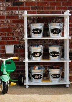Set up an outdoor shelf stocked with labeled buckets to store the things you use in your yard.