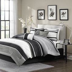 Update your bedroom decor and add a modern look with the Madison Park Blaire Comforter Set. The chic comforter set highlights beautiful layers of ivory, black, and charcoal grey for a unique striped design, adding a warm and stylish touch to your bedding.