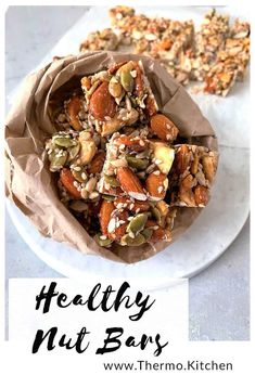 Recipes Snacks Bars Delicious Healthy Munch Nut Bars These crunchy, little nut bar bites are the perfect on the go snack. Using only a few natural ingredients, they're nutritious & so easy to make. Thermomix Recipes Healthy, Nut Recipes, Lunch Box Recipes, Cooking Recipes, Healthy Slice, Healthy Bars, Healthy Snacks, Healthy Eating, Healthy Cookies