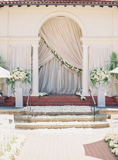 Event planning and design by Downey Street Events.  Photo by Michelle Beckwith.  Venue: Villa Montalvo. Draped archway with florals.