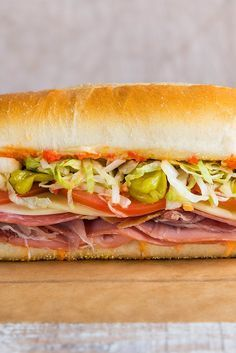 This Italian sub is loaded with cured meats, cheese and herbs, then smothered with a pickled cherry pepper spread and topped with oil and red wine vinegar.