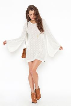 Such a cute vintage looking white dress, love