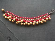 Red Coral ballwoven dark brown waxed cord and brass jingle bells bracelet For Mother day on Etsy, ฿490.20