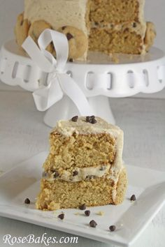 A delicious moist Chocolate Chip Cookie Dough Cake recipe!  It's a delicious moist cake with cookie dough filling and brown sugar frosting, decorated with fresh baked chocolate chip cookies!