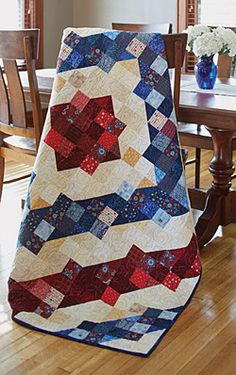 "Rings of Freedom  Fons & Porters Scrap Quilts Summer 2015  Size: 60"" × 82½"" Blocks: 88 (7½"") Split Nine Patch blocks  Rating: Intermediate"