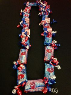 Children's 4th of July Theme Candy Lei by IslandCandyLeis on Etsy Check for more candy lei ideas at  Www.oceanicclothingdesigns.com
