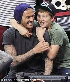 David Beckham and his son Brooklyn. So sweeeeet..