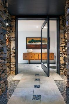 """Contemporary Front Door with Cascade Stoneworks Mexican Beach Pebble - Black 1-2"""", Modern Steel Doors Pivot Door"""