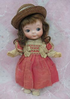 Rare googly doll, pixie-like appearance. Original dress, shoes, socks. Bisque head,.