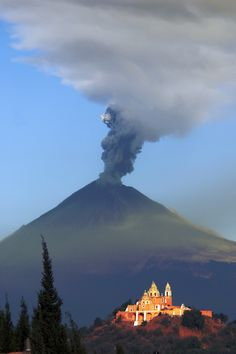 Mexico May 24, 2012. Popocateptl, and the Cholula's Church, this morning when the volcano was smoking