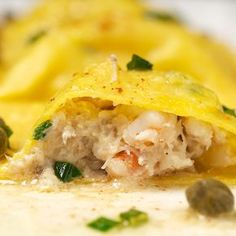 Homemade seafood ravioli with brown butter caper sauce