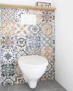 I love the idea of random mosaic tiles as a backsplash in a bathroom nook.