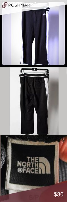 """🔘THE NORTH FACE BLACK WITH WHITE STRIPES CAPRIS🔘 🔘THE NORTH FACE BLACK WITH WHITE STRIPE CAPRIS ❤CONDITION IS VERY GOOD, the only wear is on the """"BRAND-THE NORTH FACE"""", on the front of capris! The measurements recorded with item flat, un-stretched, posted in inches below.   Size on tag: S Waist:15 Rise:9.5 Inseam:22 Total Length:31   Additional Details   Closure type: Pull Over Fabric content: Polyester🔘 North Face Pants Track Pants & Joggers"""