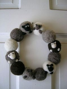 Felted Sheep Wreath - Amazing Gift Ideas to Make Out Of Your Sheep's Wool | DIY Christmas Gift For Friends and Family by Pioneer Settler at http://pioneersettler.com/amazing-gift-ideas-make-sheeps-wool/