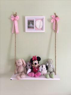 Plain white shelf turned into stuffed animal swing
