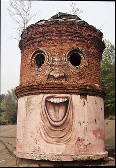 """Russian street artist Nikita Nomerz makes old buildings come alive by painting facial features on the façade. Nikita travels around to various cities bringing his unique art form to structures such as water towers and old abandoned buildings"""