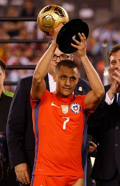 #COPA2016 #COPA100 Alexis Sanchez of Chile holds up the Best Player Award following the championship match between Argentina and Chile at MetLife Stadium as part of...