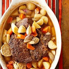 An oven or slow cooker turns an inexpensive beef pot roast into a succulent, tender feast. Vegetables cooked with the roast make for a simple, but filling meal.