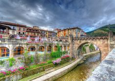 Potes, Spain In Spain's mountainous north, Potes straddles steep, river-choked terrain and is home to several centuries-old stone bridges, including the famous San Cayetano and La Cárcel that span the Quiviesa River.