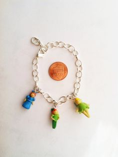 Disney's Peter Pan Inspired Clay Charm Bracelet by aWishUponACharm, $10.00