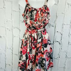 "SALE ELLE Floral Summer Dress Adorable Elle Floral Summer Dress 34"" from top of shoulder to bottom of the Dress 17"" from armpit to armpit Lined 100% Polyester Elle Dresses"