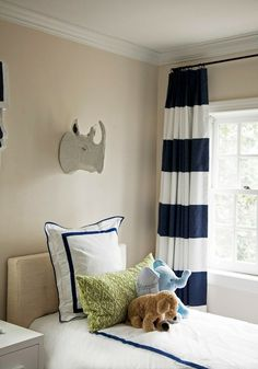 Adorable boys' room with tan walls paired with white and navy blue horizontal striped curtains. Horizontal Striped Curtains, Blue Striped Curtains, Navy Curtains, Playroom Curtains, Bedroom Curtains, Baby Boys, Baby Boy Rooms, Kid Rooms, Kids Bedroom