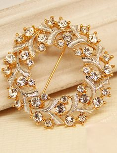 Broche dorado hueco diamante  8.22