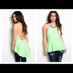 LIME MINT HIGH LOW PEPLUM TOP W/OPEN LOW BACK NWT and made by luxxell in a size small fitting 32-34 inches in the chest and waist up to 27 inches.  Medium chest 34-36, waist 29, or large chest 36-38, waist 31.  Done in a lime mint green.  It is fully lined with a lace overlay.  It has a scoop neckline, an open back with adjustable cross straps and a silver back zipper and ruffled hem that is longer in back then in front.  It is made of 65% cotton and 35% nylon and the lining is made of 97%…