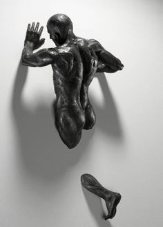 Sculpture of a man who can walk through walls...