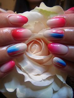 You can do a lot with colors on your nails; this red and blue combination…