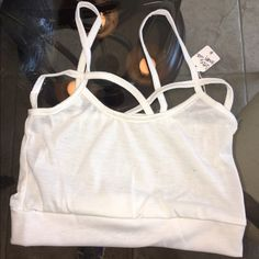 NWT. White cotton tank size O/S NWTstrappy cotton, bra top in white and size O/s Tops Crop Tops