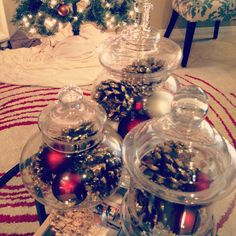 Easy DIY Christmas decorations! Fill apothecary jars with bulbs or glittered pinecones. Even a string of (no plug needed) lights!