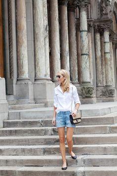 white blouse denim shorts & flats