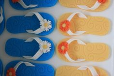 These are the sugar paste toppers for some very cute flip flop cookies I made using blue and yellow embossed sugar paste, with orange and white daisies. The design was copied from a fab Lindy Smith book.