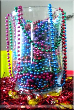 great centerpiece idea to use those bags and bags of mardi gras beads from years past.