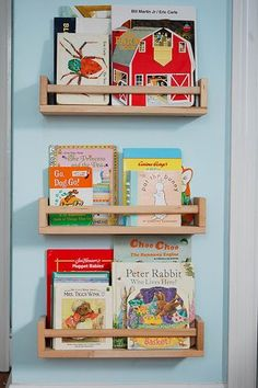 **kids book shelf made from Ikea BEKVAM Spice Racks-- paint whatever color to match room**