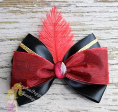 Jafar inspired hair bow. Measures about 4.5 across.    All bows are made in a smoke free environment and the ends of the bows are heat sealed to