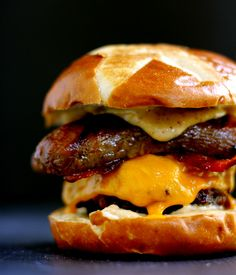 Sweet and Smoky Bacon Brat Burger Looking for a burger recipe to wow guests? Melanie Bauer of Melanie Makes shared this quarter pound beef burger topped with cheese, brown sugar glazed bacon and a split bratwurst on Instagram. Between that pretzel bun and the smoky mustard oozing down the side, we can't look away. Image Credit: @melaniemakes  via @AOL_Lifestyle Read more: http://www.aol.com/food/14-recipes-kick-summer-right/?a_dgi=aolshare_pinterest#fullscreen