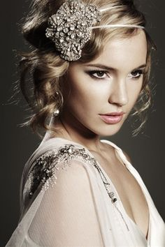 Beautiful vintage piece in her hair. All the bridal glam, no worries about packing a veil.