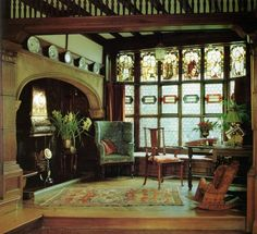 Hall at Wightwick - stained glass and enormous fireplace.