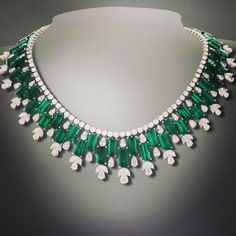"""A stunning necklace in unique shapes of Zambian emeralds by #heeramaneckandson. One of India's…"""