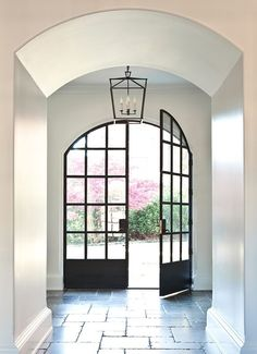 We love a handsome set of iron doors. Via Atlanta Homes & Lifestyles. Iron Front Door, Iron Doors, Arched Front Door, Arched Doors, Front Entry, Style At Home, Steel Windows, Windows And Doors, Steel Doors