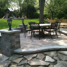 Naperville Patio Design Features A Seat Wall With Lighting And Multiple  Levels To Help Define Seating