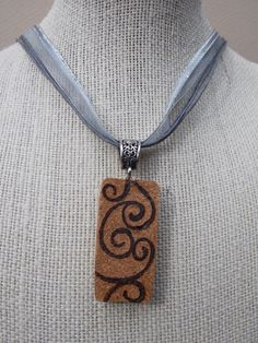Hey, I found this really awesome Etsy listing at http://www.etsy.com/listing/128734715/wine-cork-pendant-with-swirls